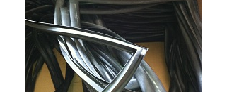 Rubber container door seals with molded corners